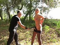 Girl in sexy stockings tormented in the woods